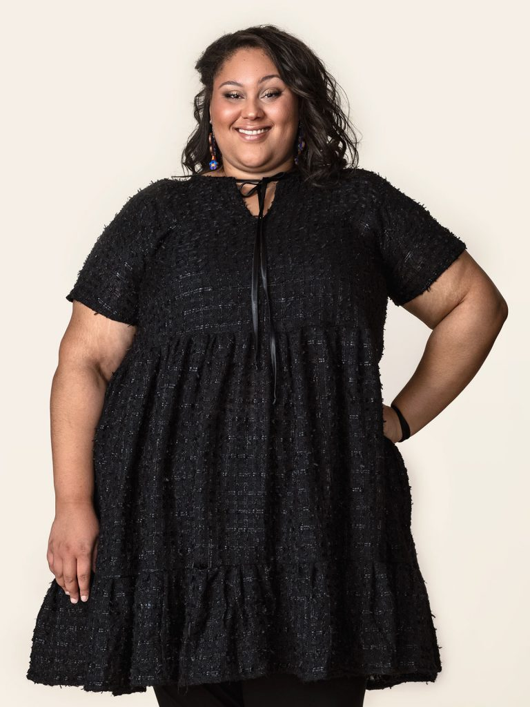 Adasha wearing a frilly black dress by designer Miia Halmesmaa for Weecos.com Curves campaign for plus sizes. The aim of the campaign was to make women of all sizes feel comfortable with wearing sustainable fashion.
